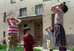 Children look up at fighter jets enforcing the no-fly-zone over Sarajevo, Bosnia Herzegovina, on May 12, 1993.