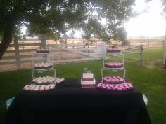 Black and pink wedding cupcakes and small tiered cake