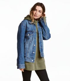 Denim blue. Straight-cut jacket in washed denim with distressed details. Collar, buttons at front and at cuffs, and chest pockets with flap and button.