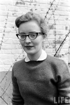A girl wearing cat's-eye glasses photographed by Joe Scherschel for Life magazine, 1950s.