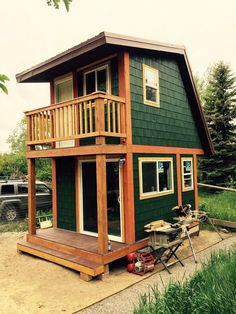 Jackson Hole 2 story tiny house wooden materials and nice front views porch design Tiny House Swoon, Tiny House Cabin, Tiny House Living, Tiny House Plans, Tiny Cabins, Tiny Cottages, Log Cabins, Living Room, Two Bedroom Tiny House