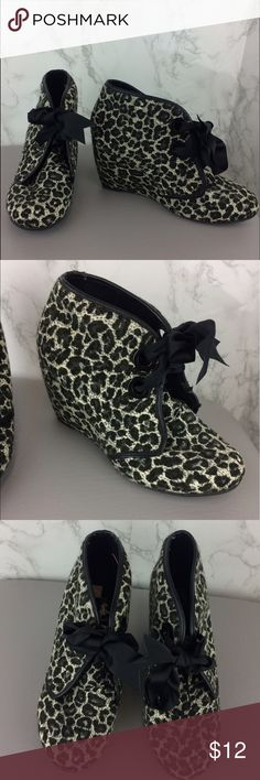 """SUGAR Wedge Animal Print Fabric Bootie Size 6 1/2 SUGAR brand Wedge Bootie. Animal Print Fabric in black, cream, and gray. All man made materials. Grosgrain black ribbon lace up.  3 1/2"""" Heels. Small amount of peeling on faux leather trim. Please refer to pictures for condition.  Size 6 1/2. Sugar Shoes Ankle Boots & Booties"""