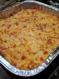 Sour cream, cheddar cheese, real bacon bits, ranch dip mix, frozen shredded hash brown potatoes. YUM! Just like twice baked potatoes but waaaaay easier!