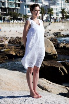 Linen Peasant dress. Made for that everlasting feel of summer and youthfulness. This is perhaps the most fitting selection if you are buying your first item of linen clothing. This is a sleeveless loose-fitting dress with inseam pockets. The silhouette is crisp and clean.  French peasant dress. Flax plant. Cape Town. Africa. Women Fashion. Natural clothing. Freedom. Linen clothing. Flax Plant, Natural Clothing, Cape Town, Clothing Items, Summer Time, The Selection, Crisp, Going Out, Freedom