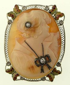Antique Victorian Carved Shell Cameo Pendant/Brooch Depicting A Woman In Profile, Wearing A Diamond Necklace And A Diamond In Her Hair, Bezel Set In 14k White Gold Surrounded By Enameling And Diamond Chips - Signed