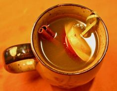 """10 Hot & Boozy Drinks to Get Cozy With This Winter including this one a """"Hot Apple Ginger Toddy"""""""