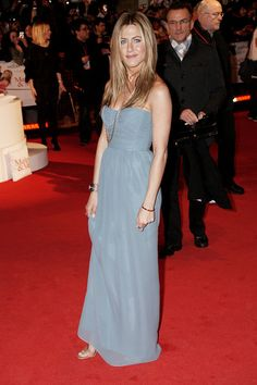 Jennifer Aniston Strapless Dress - Jenn braved the London cold in this Burberry frock. She paired the simple but elegant gown with layered necklaces and sleek hair.