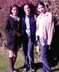 Outdoors: Meghan and two of her friends posed for a photo in Meghan's mother's garden in Los Angeles around 1993