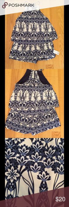 Romper Dee Elle romper, spaghetti straps in navy blue and white floral pattern. Size large. New with tags! Dee Elle Other