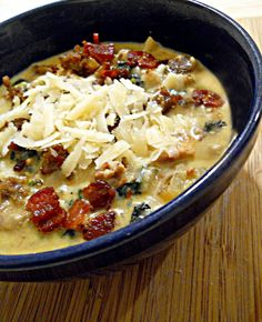 Zuppa Tuscana.  Substitute cauliflower for the potatoes and you've got a low carb meal!  4 slices bacon, diced 1 lb ground hot Italian sausage 1 large yellow onion, diced 4 cloves garlic, minced 4 cups (32 oz) chicken stock 3 cups russet potatoes, cubed 3/4 tsp sea salt 1/4 tsp freshly ground black pepper 2 cups kale, in bite size pieces 1 cup heavy whipping cream parmesan cheese, grated