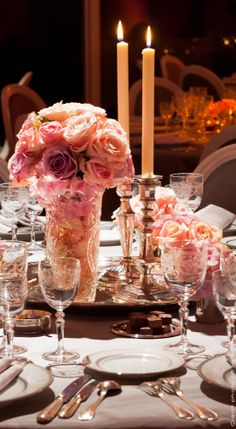 Table setting with silver and pink roses, pink candles