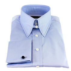 Our powder blue slim-fit tab collar shirt is cut in an exceptionally fine Italian cotton satin and can be matched to any variety of colours with ease.