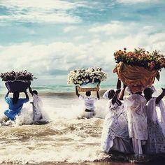 flower offerings for Yemanjá, queen of the sea, feminine principle of creation