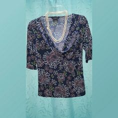 ⤵⤵💲 SALE TOP , NAVY SIZE M EXTRA DISCOUNT...JUST LET ME KNOW WHAT TO BUNDLE. .LADIES NAVY AND PINK FLORAL TOP...SPANDEX/POLYESTER BLEND..DEEP V NECKLINE...SIZE M. WORN TWICE. NON SMOKER...EXCELLENT CONDITION. George Tops Blouses