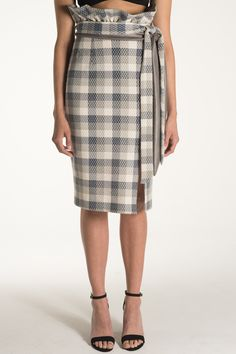 Meet Daphne.   Double belted pencil skirt in checker patterned fabric. High waisted exaggerated paper sack style waist and left leg slit make this a feminine and flirty twist on a classic.  Available for pre-order NOW!