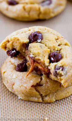 The ultimate sweet & salty treat! Thick and chewy chocolate chip cookies stuffed with gooey caramel and topped with sea salt.