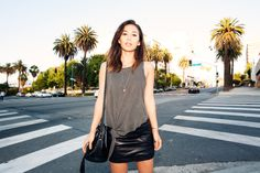 "fashiontoast | 07/10/2014 across the street from golden hour Wearing a Project Social T knotted tank, Alexander Wang leather mini, Altuzarra mules, and a Faustine Paris ""Gill"" bucket bag."