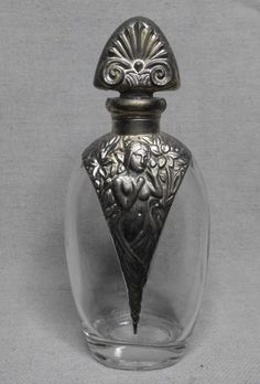 Antique perfume bottle with nudes. 5-1/2 x 2-1/2