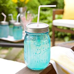 Get the nostalgic look of antique blue glass canning jars. Mix transparent blue glass paint with paint thinner. Paint the mixture onto the outside of the jar -- try to avoid drips and runs. Let dry, then bake the jar in a 350°F oven for 20 minutes to set the paint. Punch a hole slightly larger than a straw into the top of the jar lid and add a fun straw for old-fashioned flair.
