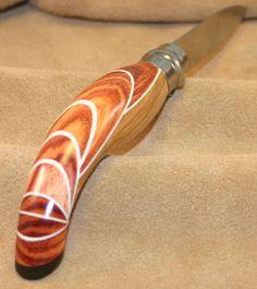 Opinel custom en olivier, bois de rose et corne de bélier
