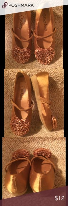 Coco Jumbo Gold/Tan Satin Shoes Gold or tan color satan shoes with decorations on the toes and elastic strap. Size 8 1/2 toddler. NWOT Coco Jumbo Shoes Dress Shoes