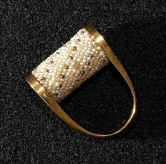 Ring by Jacqueline Lillie. Freshwater pearls and seed beads individually knotted, 18Kt gold mount, 2002.