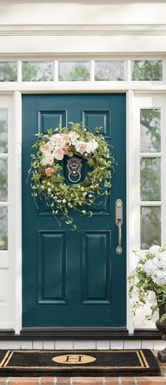 I love these traditional front door updates because they have a timeless and classic vibe that will stand the test of time. The floral wreath breathes life into this front door and prevents it from looking or feeling too stuffy. Isn't the lion head door knocker so cute?! I think it's my favorite detail of this front door. Closely followed by those charcoal urns – love! Which of these three front doors is your favorite?