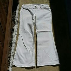 "Gap 1969 Flare Jeans Gap Premium Flare 1969 White Jeans with stretch. Size 14 with 32"" inseam. Very white! discoloration UNDER cuff only. The perfect summer jean! Cha cha xo GAP Jeans Boot Cut"