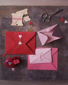 DIY Heart Seals    Tug at your valentine's heartstrings with an embellished envelope. Cut out the hearts from colored card stock using a specialty hole punch (available at crafts stores). Poke two holes into each heart with a needle, then sew the hearts onto dual-capacity envelopes (buy your own or download our template) using the needle and silk beading cord. Secure stitches with a double knot on the backside of the flaps. After inserting the valentine, close the envelope by winding a…