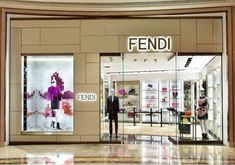 lighting company s logo illuminated from behind plus The new Fendi boutique  inaugurated at the Galaxy Mall in Macau 38ad9b85b1a