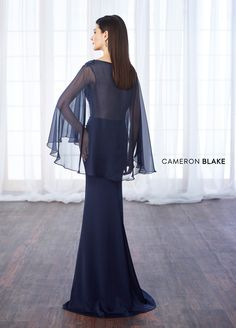 217638 - Satin crepe, chiffon, and lace fit and flare gown with bateau illusion neckline, hand-beaded lace sweetheart bodice, attached cape with back keyhole creates draped three-quarter length sleeves, sweep train.
