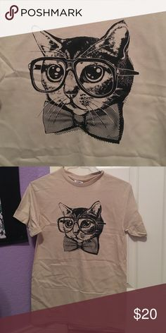 Cat Bow Tie Shirt Super cute shirt of a cat wearing glasses and a bow tie. Brand new. Never worn or washed. PLEASE READ THE ENTIRE DESCRIPTION BEFORE PURCHASING!  NO TRADES. NO HOLDS. NO MERC@RI  I only respond to offers made through the offer button   Questions? Just ask! Serious inquiries only please. EVERYTHING MUST GO!!  Tops Tees - Short Sleeve