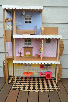 "Cardboard Doll House. I pinned the ""cardboard tutorial"" from Ikat Blog a few days back, and today I found this... I swear this is one super patient and super creative mom! Just check out the level of detail in this one. It has an elevator, stairs, a locking gate, sliding door, hinged door, curtain with loops, lights, picture frames..... O.M.G!!!!!"