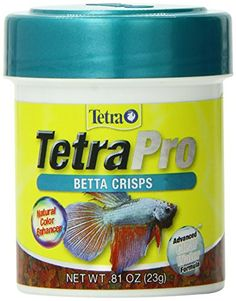 I have been using this variety of food for the community tank for years. It is a good combination for floating then sinking, to keep all level feeders happy. Little waste. I don't know how much difference the color adds. If you take good care of your fish, they will have good colors. Since my fish are >10 years old, I don't think the food is doing them harm.