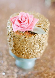gold wedding cake - photo by Debbie Lourens Photography http://ruffledblog.com/smitten-with-sparkle-wedding-inspiration #weddingcake #cakes #goldwedding
