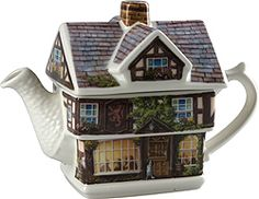 Red Lion Pub Teapot   The village pub is the scene for this charming tea pot, complete with dining folks and pub sign. Here dogs are allowed inside, but this fellow in the door seems to know you. Relax and stay a while. James Sadler design.