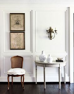 http://eclecticrevisited.com/2012/01/06/pretty-chairs/foyer-french-decorating-gilded-prints-sconce-hbx/