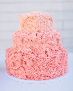 Pink wedding cake  SusieCakes piped the vanilla confetti cake's lemon buttercream in a pink ombre swirl pattern. It was served with homemade ice cream sandwiches in two varieties: ginger cookie with vanilla, and chocolate cookie with espresso filling.