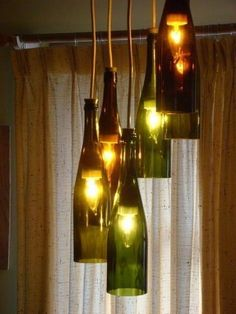 To replace the light over our dining room table Wine Bottle Chandelier, Diy Chandelier, Dining Room Table, Kitchen Lighting, Christmas Cookies, Wine Rack, Mason Jars, House Design, Photo And Video