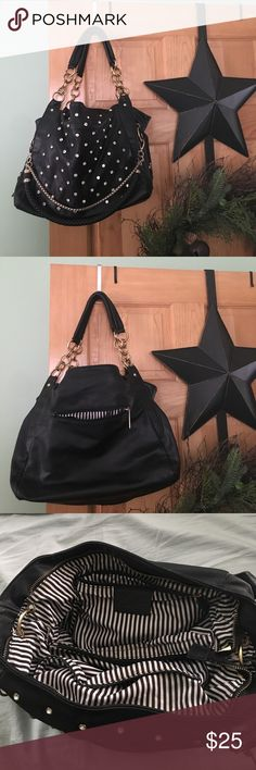 Beautiful Large Fashion Bag Beautiful Large Fashion Bag. Black with gold chains and rhinestones all over the front of the purse. Purse is still in great condition. Was my favorite bag so took great care of it! Bags Shoulder Bags