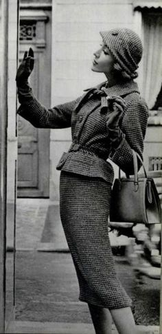 This outfit shows off a similar silhouette to Christian Dior's New Look with a nipped waist, padded hips, and broad shoulders. The one main contrasting feature is the narrow pencil skirt as opposed to the fuller skirts. -Annika Severtson