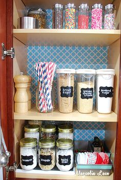 Organized Baking Cabinet Using Baking Supplies || I <3 the idea of using loaf pans to store cupcake liners!
