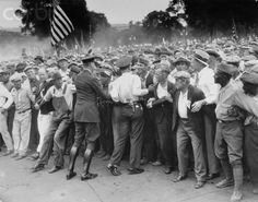Police try to hold back members of the Bonus Expeditionary Force, a group of 15,000 veterans of WWI who marched on Washington to demand full payment of their war bonus during the Great Depression. July 16, 1932