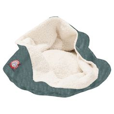 Perfect for burrowing breeds, this snug pet bed features a cozy sherpa interior and faux suede cover.  Product: Pet bed C...