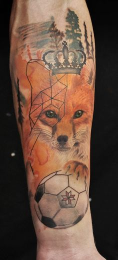 Freshly done, colorful lovely fox tattoo on mans arm.  Artist Janis Andersons #fox #tattoo #foxtattoo #animal #animaltattoo #armtattoo #color #colour #crown #watercolor #tree #football #geometric #latviansign #wildlife #nature #foxface #pines #riga #tattooinriga #tattooed #art #tattooink  #ink #inked #skin #tattooartist #tattoofrequency #share #like #follow