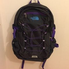 North face women's boreal is backpack Fabric painted from magenta to dark purple. 2 large zipper pockets with more small compartments inside, 2 water bottle side holders, a small pocket in the front. The North Face Bags Backpacks