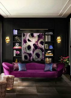 The purple #sofa adds a royal touch to the #room. #BlackInteriors #HomeIdeas