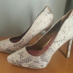 Sam Edelman Heels Snake skin heels never worn. Never worn because they were a gift that was to small for me. Sticker still on the bottom of shoe. Willing to hear offers. Sam Edelman Shoes Heels