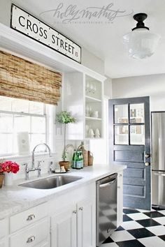 Bamboo shade, crown molding spanning the length of the upper soffit, counters.