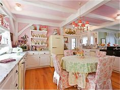 Another view of The Dreamy Feminine Kitchen. Carrera Marble counter tops, Box Beam Ceiling, open shelving with Scallop details, Toile covered chairs, Scallop edge repeats on table cloth. LOVE THIS PLACE!  1008313_10 Kirstie Alley's Home, For Sale. Photos courtesy of Interior Design website HomeBunch#
